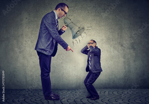 Angry mature business man boss screaming at small himself in megaphone Fototapet