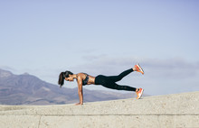 Muscular Woman Doing Core Exer...