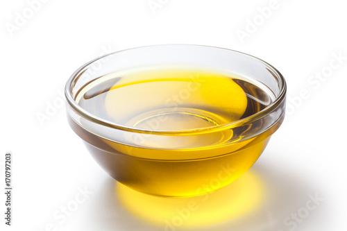 Fototapeta A bowl of olive oil isolated on white background obraz