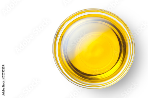 A bowl of olive oil isolated on white background