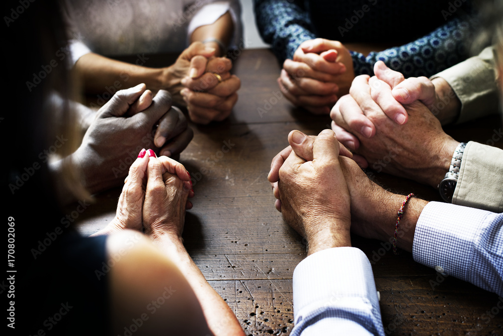 Fototapety, obrazy: Group of interlocked fingers praying together