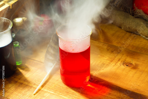 Foto  red Potion with smoke or fog on wooden background