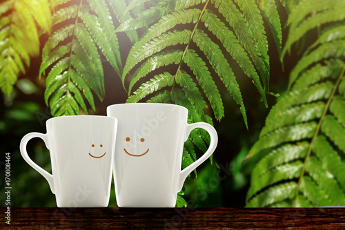 Fototapeta Happy Lover Coffee Cup with smiley face, Happiness and Romantic Love moment Conc