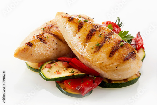 Fototapeta Grilled chicken breast with zucchini and capsicum obraz