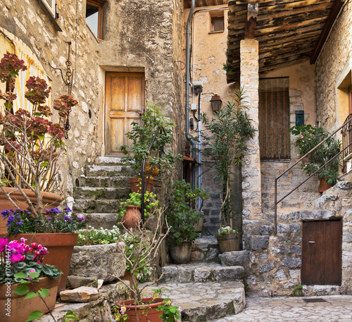 Patio with flowers in the old village France