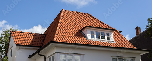 Fototapeta roof of house with red tiles obraz