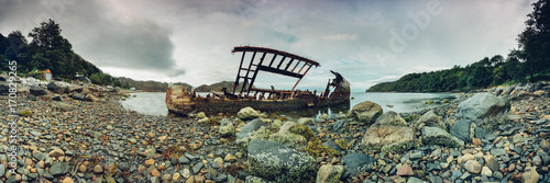 Photo Stands Shipwreck Old wooden shipwreck on a beach on the North-West of Scotland. Scottish Highland, UK