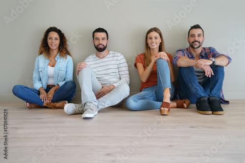 Fotografie, Obraz  group of friends sitting on floor