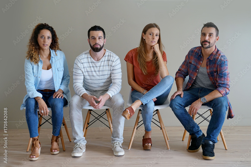 Fototapety, obrazy: Group of young people sitting on chairs, isolated