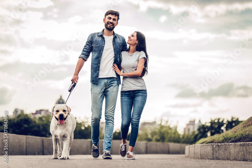 Couple on a walk with dog Wallpaper Mural