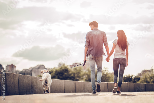 Couple on a walk with dog Canvas Print
