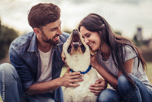 Couple with dog Canvas Print