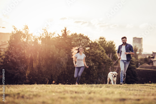 Couple with dog Wallpaper Mural