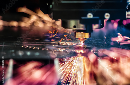 Valokuvatapetti CNC Laser cutting of metal, modern industrial technology.