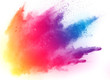 Leinwandbild Motiv abstract multicolored powder splatted on white background,Freeze motion of color powder exploding