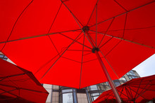 Three Red Patio Umbrellas As Seen From Bottom. Cafe Umbrellas Filling Frame Close Up