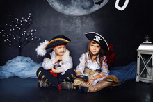 Boy And Girl In Pirate Costume...