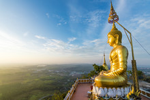 Big Gold Buddha Statue At The Sunrise In Tiger Cave Temple In Krabi Province, Thailand