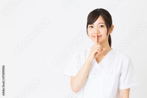 Photo portrait of asian nurse isolated on white background