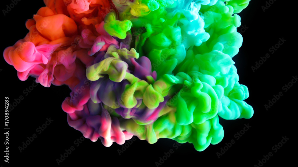 Fototapety, obrazy: Colorful rainbow paint drops from above mixing in water. Ink swirling underwater. Cloud of ink isolated on black background. Colored abstract smoke explosion effect. Close up view