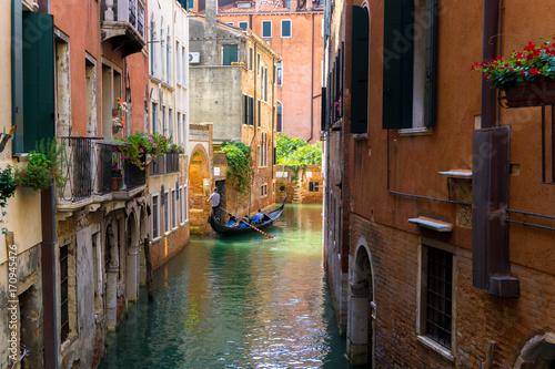 colorful Venetian Canal with gondola, Venice Italy © luili