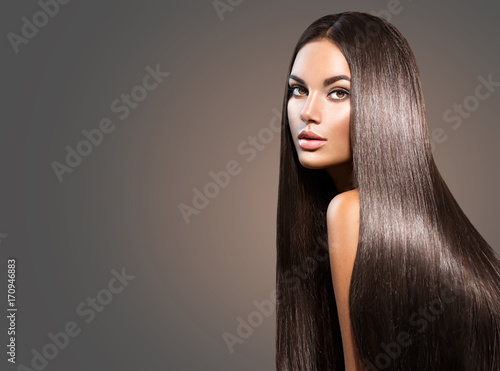 Obraz Beautiful long hair. Beauty woman with straight black hair on dark background - fototapety do salonu