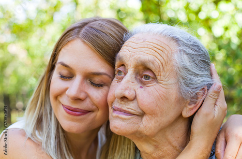 Hugging grandma in the park Canvas Print
