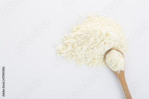 Fotografie, Obraz  Top view of powdered milk and a spoon.