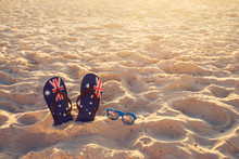 Thongs And Sunglasses On Beach...