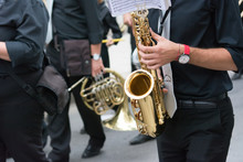 Sax Musician Walking In The St...