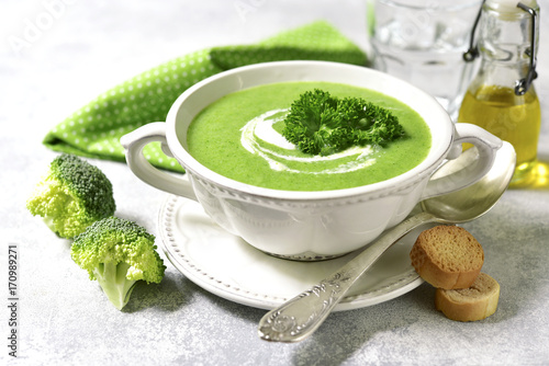 Broccoli soup in a white bowl.