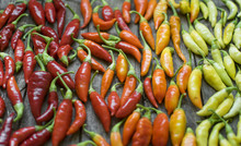 Colorful Chilli Peppers On Woo...