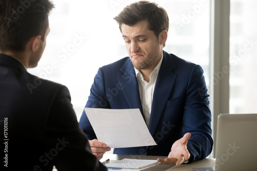 Fotografie, Tablou Unsatisfied with contract terms businessman disagrees to accept conditions of questionable agreement meeting with business partner in office