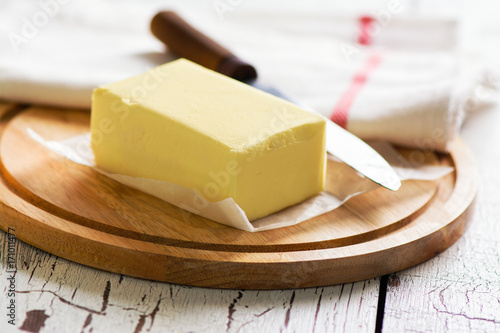 Butter block on wooden board. Baking or cooking concept