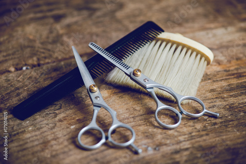 Fotografering  hairdresser tools on wooden table