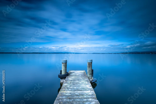 Overcast. Wooden pier. Lake to the horizon. Long exposure. Poster Mural XXL