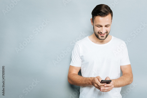 Attentive man chatting with his girlfriend Wallpaper Mural