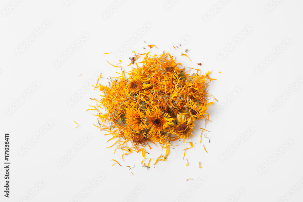 Fototapety, obrazy: Dry calendula flowers pour a handful on white