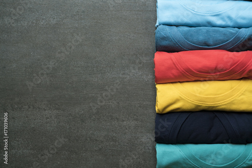 Fotografia, Obraz  close up of rolled colorful clothes on black background