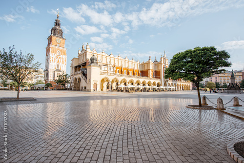 Fototapeta Cityscape view on the Market square with Cloth Hall building and town hall tower during the morning light in Krakow, Poland obraz