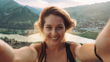 Beautiful Young Woman Doing Selfie In The Mountains