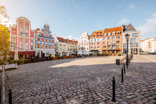 View on the Market square with beautiful colorful buildings during the morning light in Szczecin city, Poland © rh2010