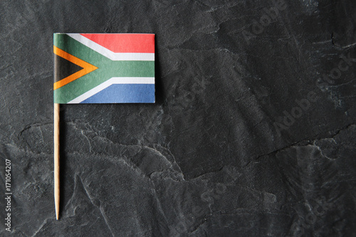 Fotografie, Obraz  A South African flag toothpick on a black slate background.