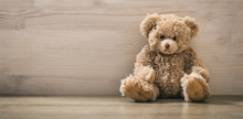 Teddy Bear On A Wooden Floor
