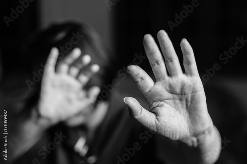 Fotografia, Obraz  Woman with her hand extended signaling to stop (only her hand is in focus)