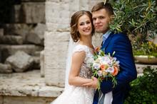 Happy Bride And Groom In A Cas...