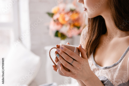 Fototapeta Beautiful young lady with cup of morning coffee in hands