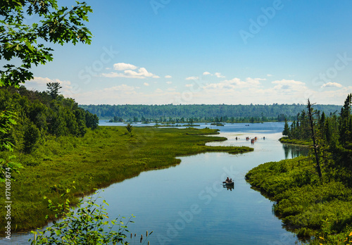 Canvas Prints Blue canoes and kayaks on northern river and lake on Madeline Island in Lake Superior, Wisconsin
