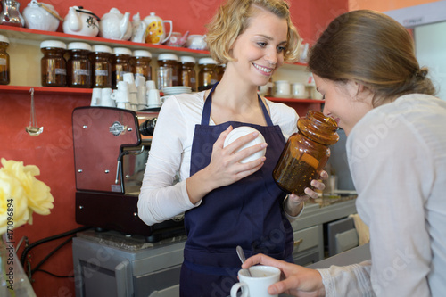 Papiers peints Café en grains female barista making customer smell coffee beansce