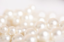 Pile Of Pearls On The White Ba...